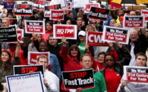 NO TPP - GROUP OF PEOPLE WITH SIGNS